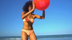 Portrait of happy slim African American woman playing on her beach holiday  Stock Footage
