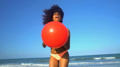 Portrait of laughing slim African American female in swimwear playing Stock Footage