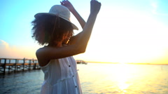 Young beautiful African American girl with afro hair enjoying leisure  Stock Footage