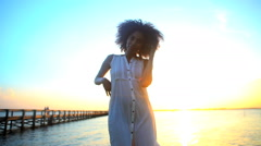 Portrait of young beautiful African American woman chilling and dancing barefoot Stock Footage
