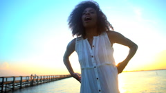 Portrait of young beautiful African American girl chilling and dancing barefoot Stock Footage