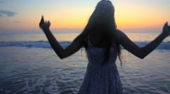 Silhouette of young cute Indian American female enjoying leisure and dancing  Stock Footage