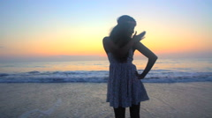 Silhouette of young beautiful Indian American girl chilling and dancing barefoot Stock Footage