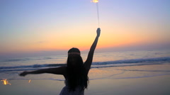 Silhouette of young slim Asian Indian girl celebrating birthday with sparklers Stock Footage