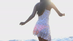 Young slim Asian Indian female wearing Hipster style dress chilling on the beach Stock Footage