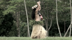 Single beautiful young synchronized Polynesian female dancer entertaining  Stock Footage