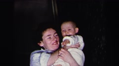 1972: happy mother holding baby girl up proudly LYNBROOK, NEW YORK Stock Footage