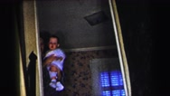 1972: grandmother and the baby walking down the steps LYNBROOK, NEW YORK Stock Footage