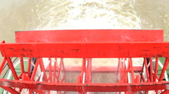 View of Steam River Boat with Paddle wheels rotating along the Mississippi River Stock Footage