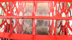 Red blades of the paddle wheel on a tourism Steam River Boat sailing along the Stock Footage