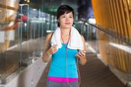 Asian Sportswoman Listening to Music in Gym Hall Stock Photos