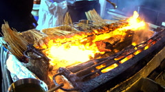 Traditional Asian meat satay street food cooking outdoor at night on a hot fire Stock Footage