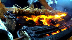 Asian traditional street food of chicken satay cooking over an open fire outdoor Stock Footage