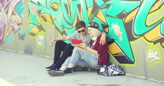 Affectionate hipster urban couple relaxing in town Stock Footage