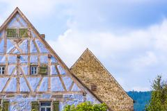 Antique German gable roofs and facades against sky Stock Photos