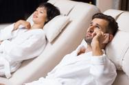 Man and Woman Relaxing on Loungers in Spa Salon Stock Photos
