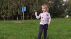 Little girl launches into the sky flying model airplane Stock Footage