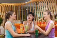 Three Women Talking in Sport Cafe after Training Stock Photos