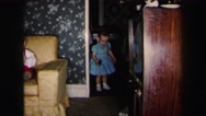 1972: two cute, well dressed toddlers playing with toys LYNBROOK, NEW YORK Stock Footage