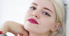 Beautiful young woman with a pierced lip Stock Footage