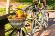 Basket of fruits on bicycle. Stock Photos