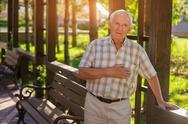 Elderly man has heart ache. Stock Photos