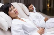 Woman and Man Relaxing on Loungers after Spa Stock Photos