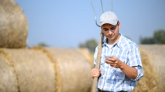 Farmer using his mobile phone Stock Footage