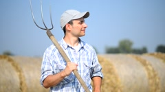 Farmer in a field looking into the distance Stock Footage