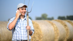 Farmer talking on the phone Stock Footage