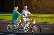 Senior couple on tandem bike. Stock Photos