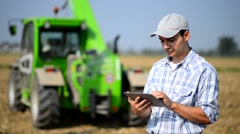 Farmer using his tablet Stock Footage