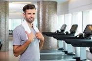 Young Sporty Man with Towel in Fitness Center Stock Photos
