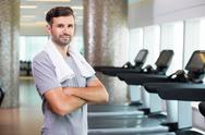 Young Sporty Man with Towel on Neck in Gym Stock Photos