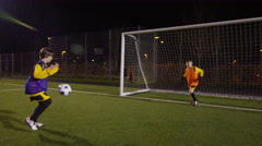 March 2016. British youth soccer team train on floodlit pitch at night Stock Footage
