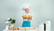 Portrait cute chef cook girl holds plate with spaghetti and gives you it Stock Footage
