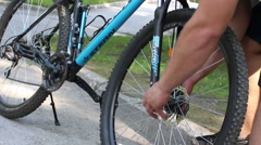 Athlete bicycle wheel mounts to the bike ride Stock Footage