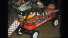 1972: christmas tree with gifts underneath featuring wagon LYNBROOK, NEW YORK Stock Footage