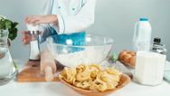 Hands of young baker using salt cellar and flour at the kitchen table Stock Footage