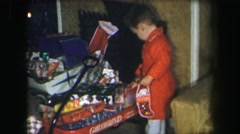 1972: good kids having fun on christmas playing with toys opening LYNBROOK Stock Footage