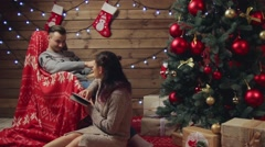 Young couple relaxing at home at xmas eve Stock Footage