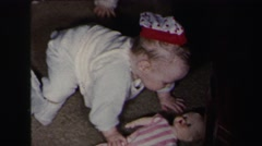 1972: twin babies crawling around on the floor playing with toys LYNBROOK Stock Footage