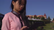 Fashionable lady with gadget outdoors Stock Footage