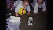 1972: children are seen indoors playing LYNBROOK, NEW YORK Stock Footage