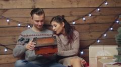 Happy couple opening magic box at xmas eve Stock Footage