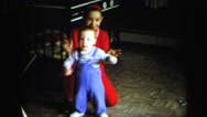 1972: girl with her little brother making funny faces and clapping LYNBROOK Stock Footage