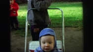 1972: baby brother trying to figure out family dynamics LYNBROOK, NEW YORK Stock Footage