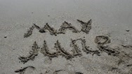 Inscription of the name of month on sand, the beach. Stock Footage