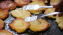 Potato pancakes in a frying pan Stock Footage