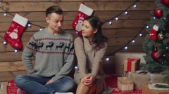 Pretty man exchanging xmas gift for a kiss Stock Footage